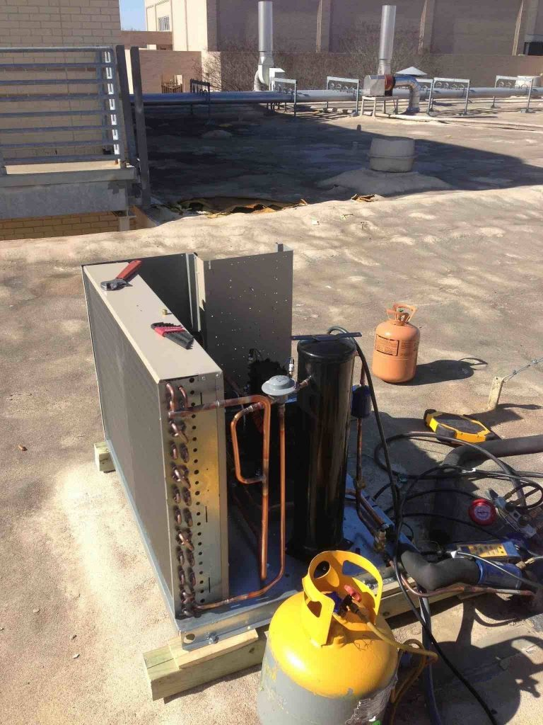 fixing a refrigerant leak on a walk in cooler condenser